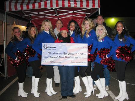 3.	Gotham City Cheerleaders and owners of Redds Restaurant in Carlstadt, N.J., presented a check for $1,700 to Denise Juarez, representing the American Red Cross.