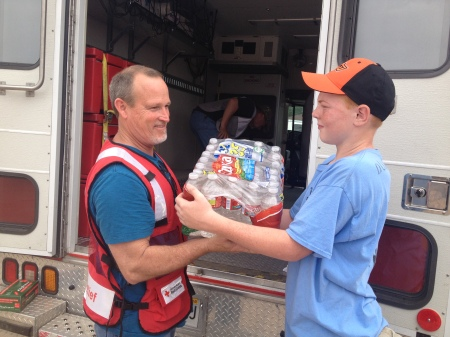 PHOTO:  13 year old steps up to volunteer his help in Moore, OK