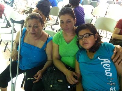 Isabel Rodríguez (left), Elizabeth Pérez (center) and Jennifer Pérez visit the Multi-Agency Resource Center set up by the American Red Cross and partner agencies in Moore, OK.